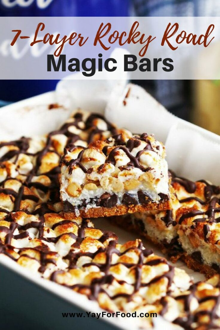 These are decadent sweet dessert bars that are extremely easy to put together. These classic magic bars have layers of chocolate chips, marshmallows, peanuts, and more!