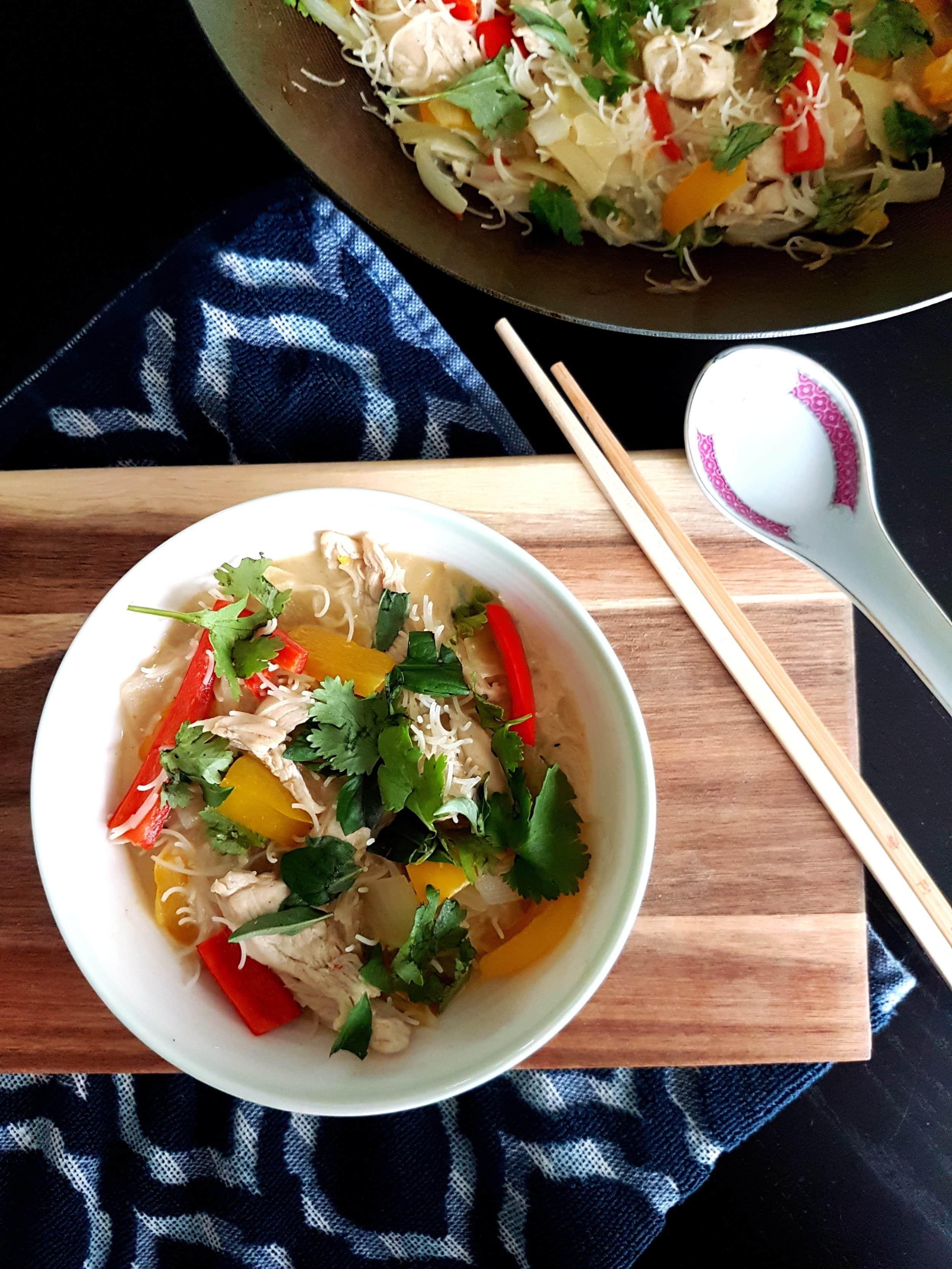 A bowl of Thai Green Coconut Curry Chicken with Rice Noodles.