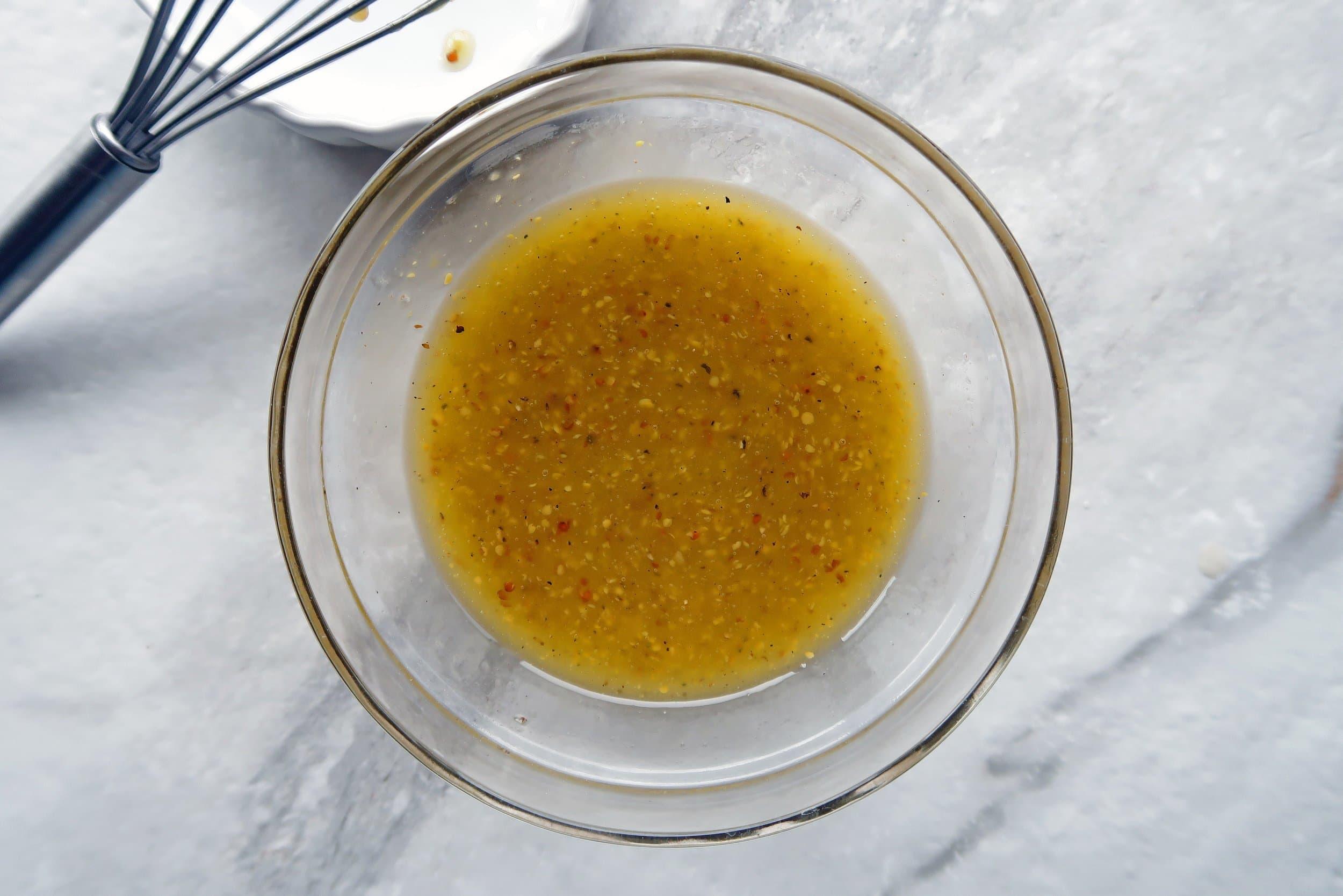 A bowl of apple cider vinaigrette.