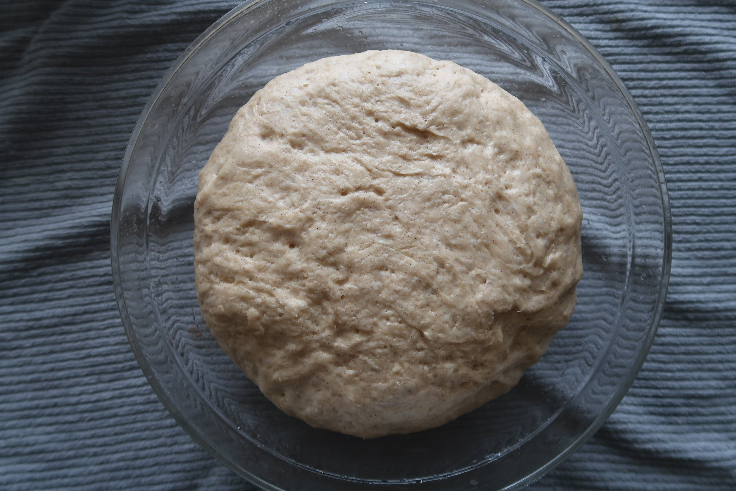 Proofed cinnamon roll dough.