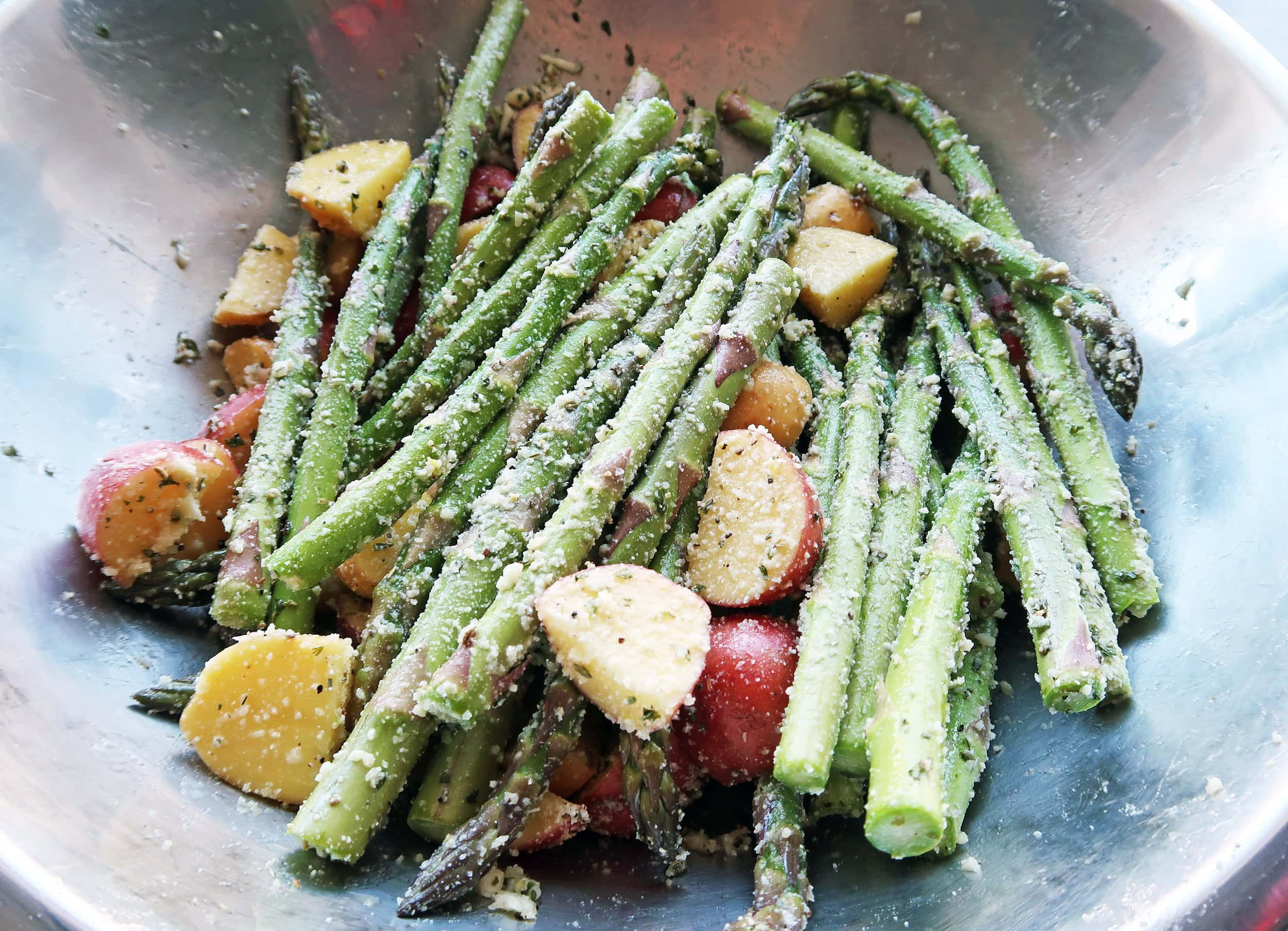 Potatoes and asparagus in a bowl.
