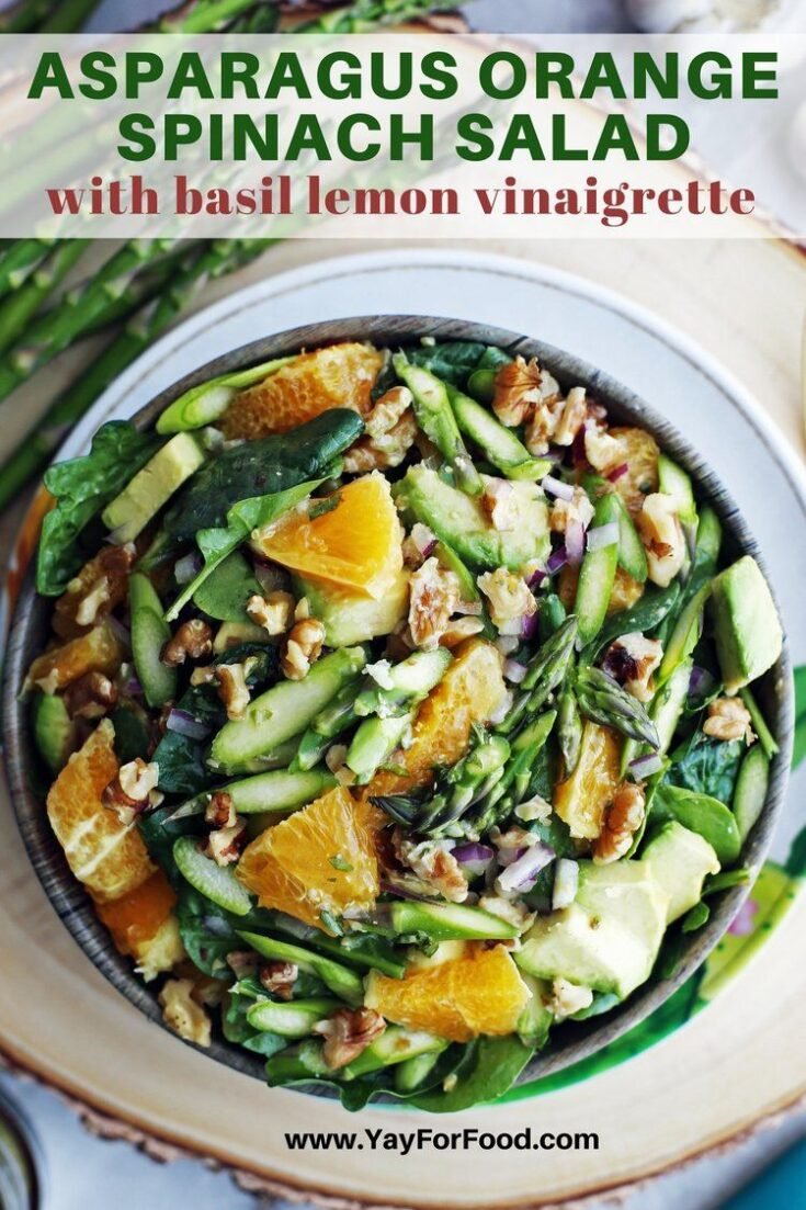 Crunchy asparagus meets the bright flavour of oranges and tender spinach in this fresh salad recipe. Packed full of healthy ingredients and topped with a basil lemon vinaigrette, this salad is vegan and gluten-free too.