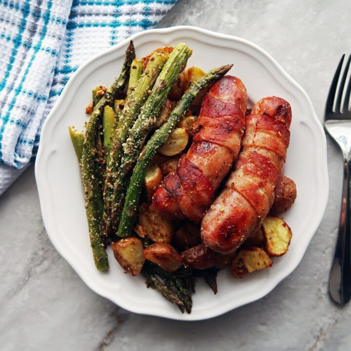 Bacon-Wrapped Sausages with Garlic Parmesan Asparagus and Potatoes