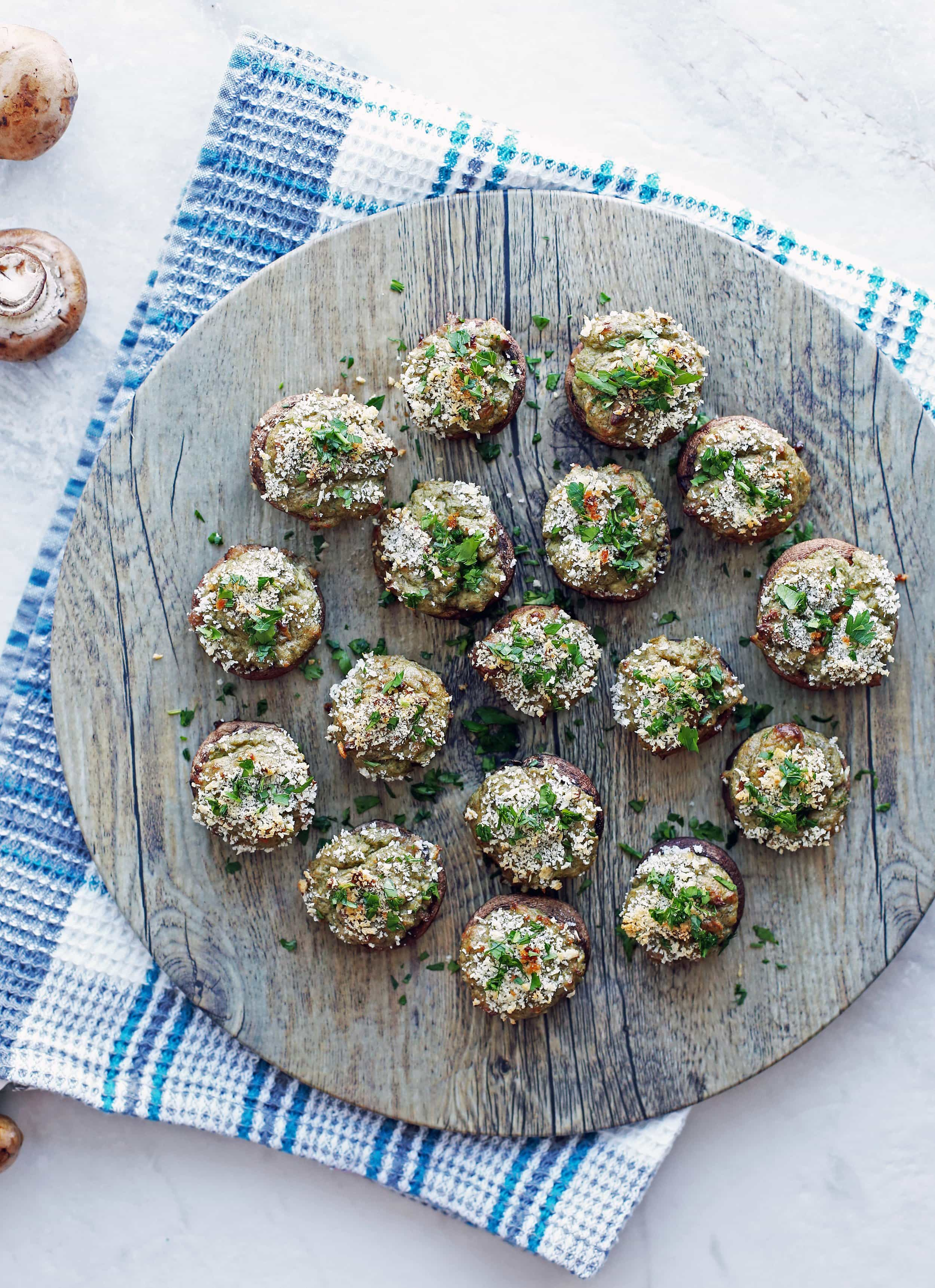 Overhead view of Baked Cheese Stuffed Mushrooms with breadcrumb and parsley topping.