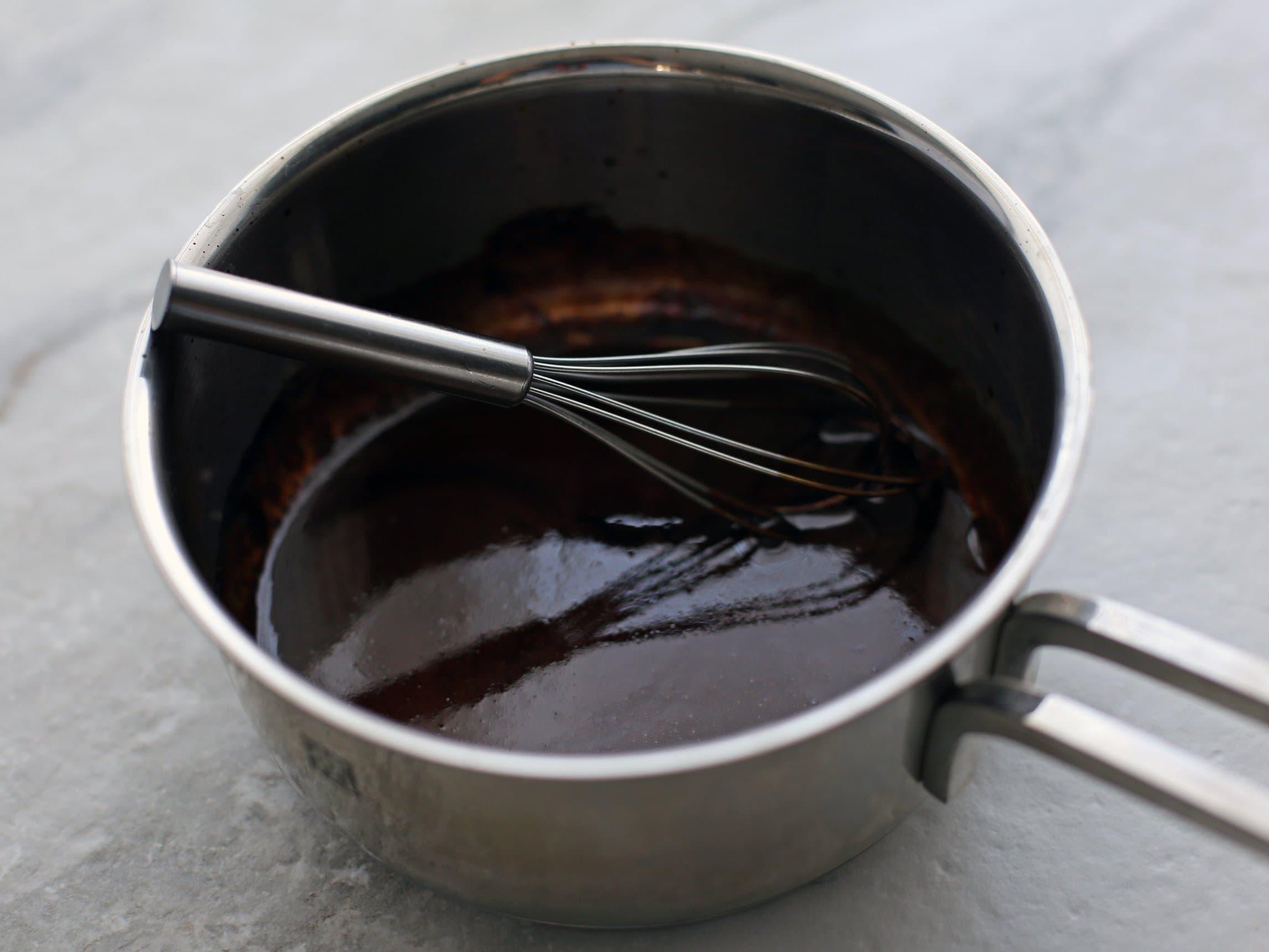 Reduced balsamic vinegar in a small metal pot.