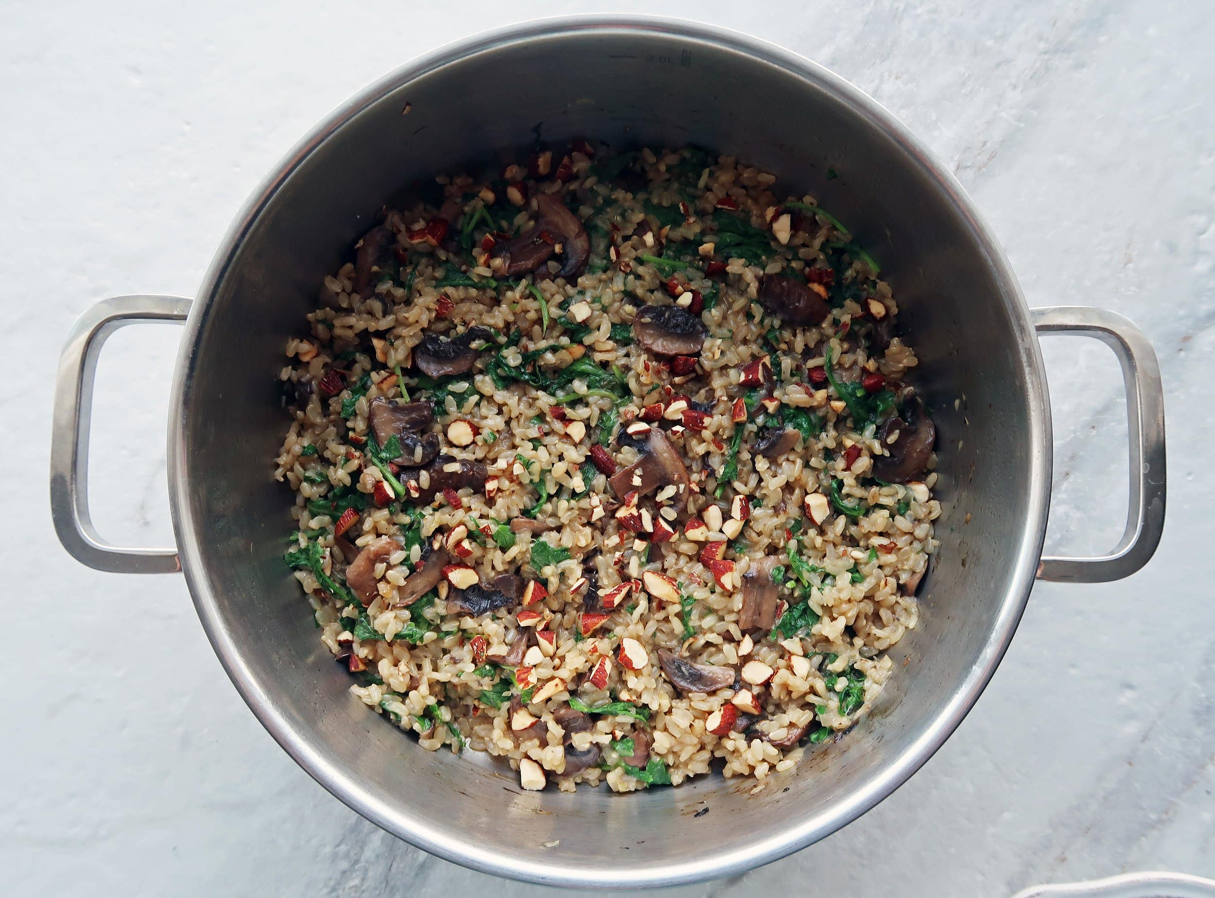 A pot of cooked brown rice pilaf.