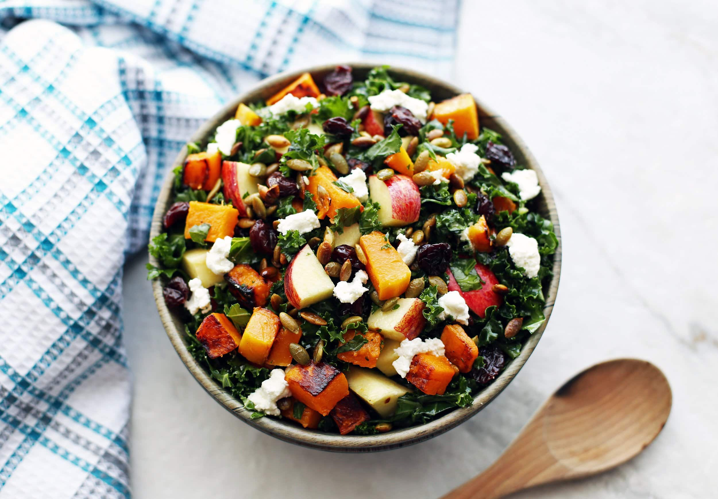 Overhead angled view of a bowl of Roasted Butternut Squash and Apple Kale Salad with Lemon Vinaigrette