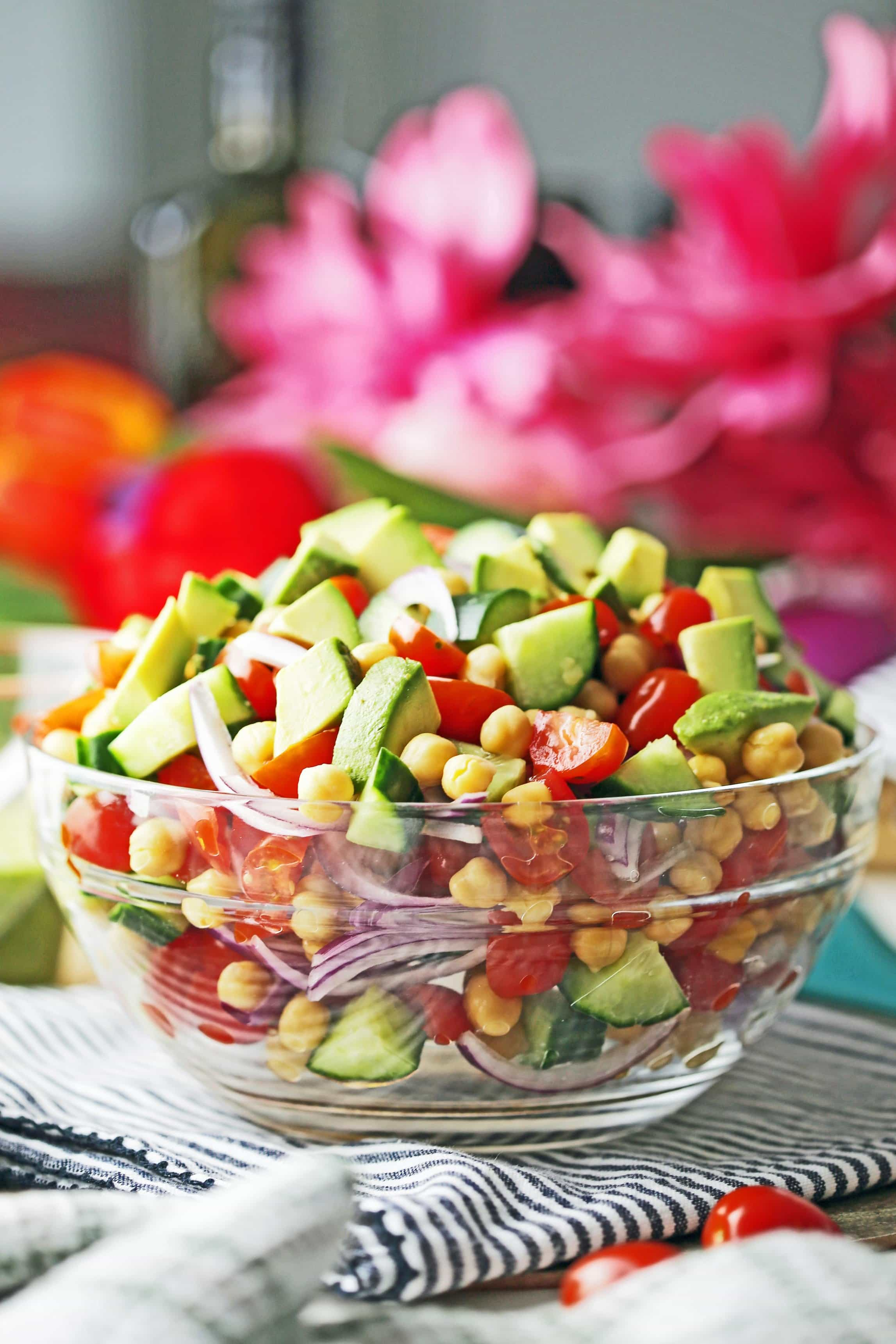 A side view of Chickpea Cucumber Avocado Salad in a large glass bowl.