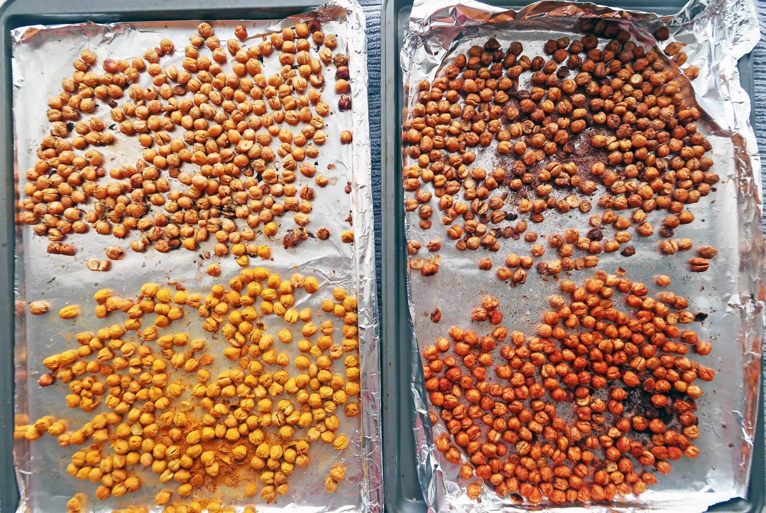 Two baking sheets featuring four flavours of roasted chickpeas.