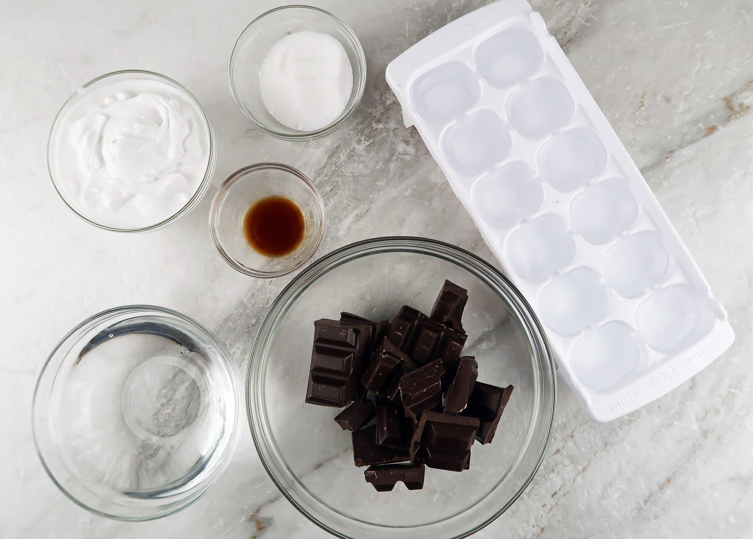 Dark chocolate, ice cube, coconut, whipping cream, and vanilla.