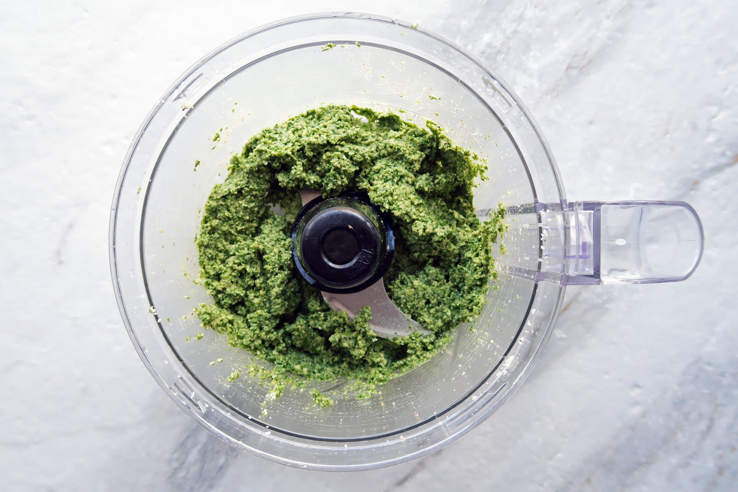 A chunky pesto in a food processor.