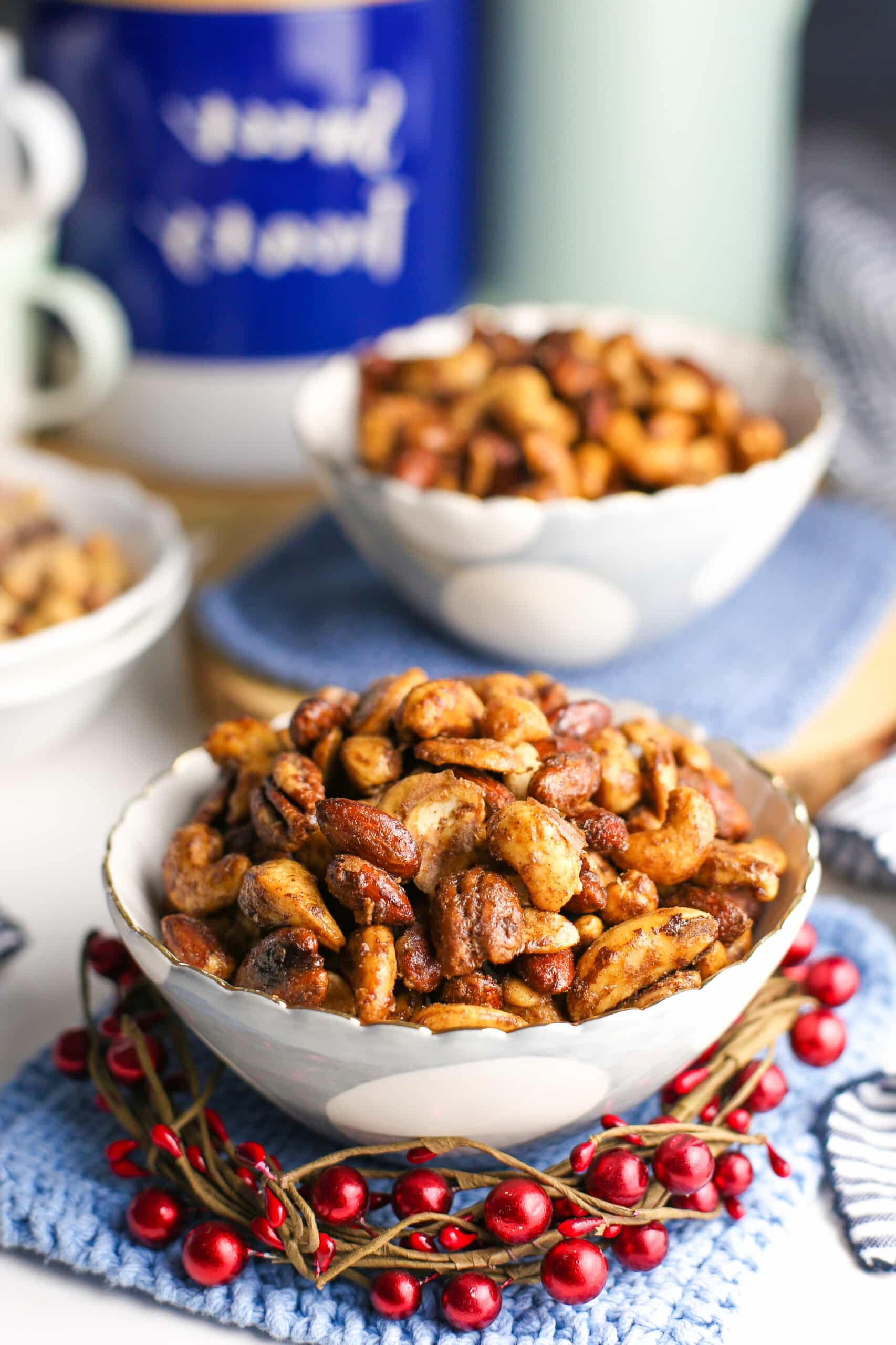 Cinnamon sugar mixed nuts in two white and blue bowls.