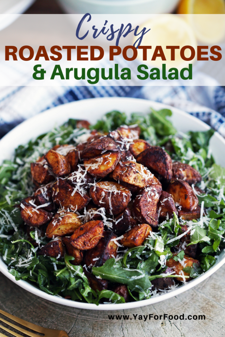 Delicious spiced roasted potatoes sit atop a bed of peppery arugula in this quick and easy warm salad recipe. A side dish that's full of bright flavours and complimentary textures.