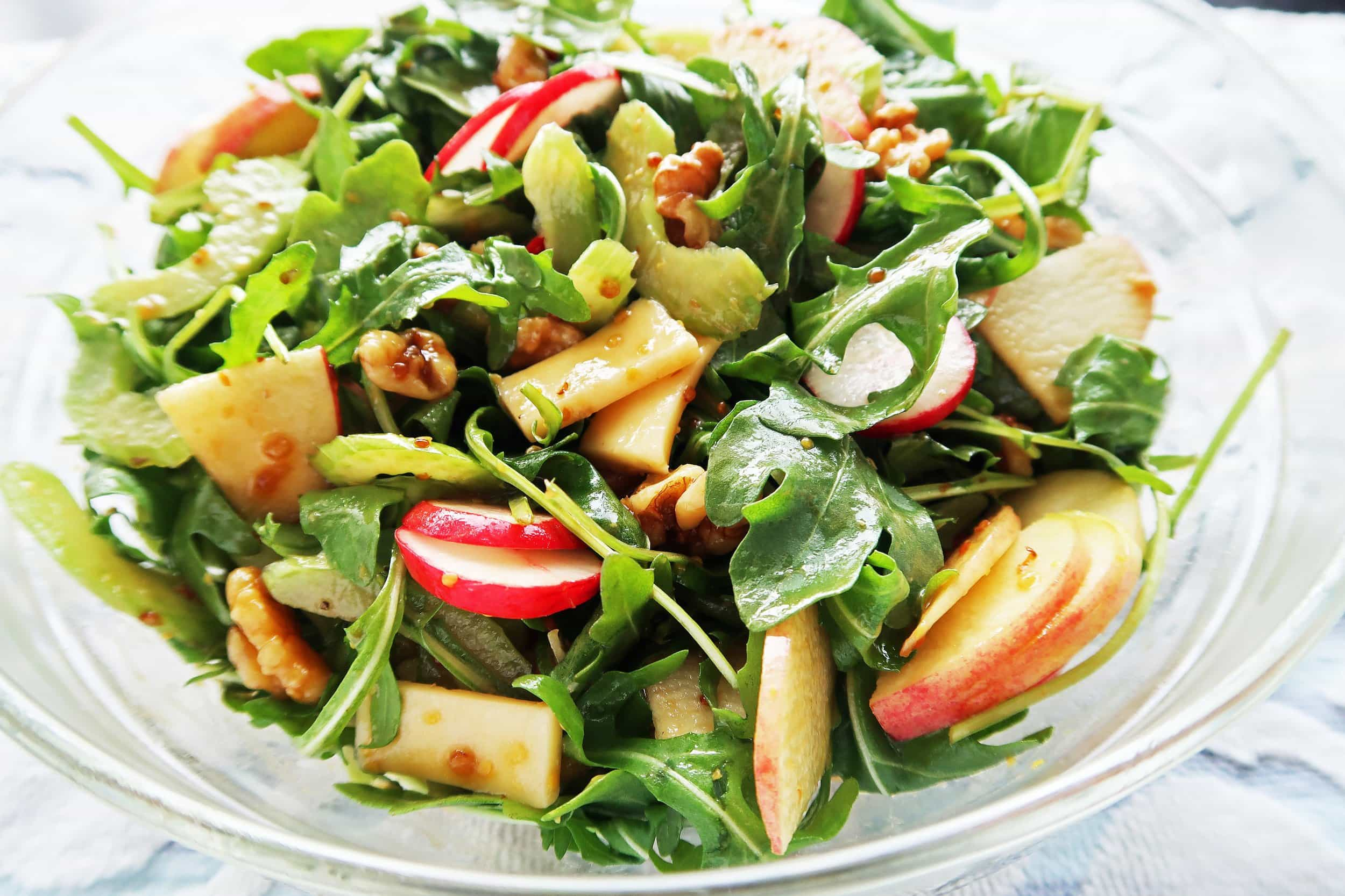 A bowl of Crunchy Winter Salad with Balsamic Honey Mustard Dressing