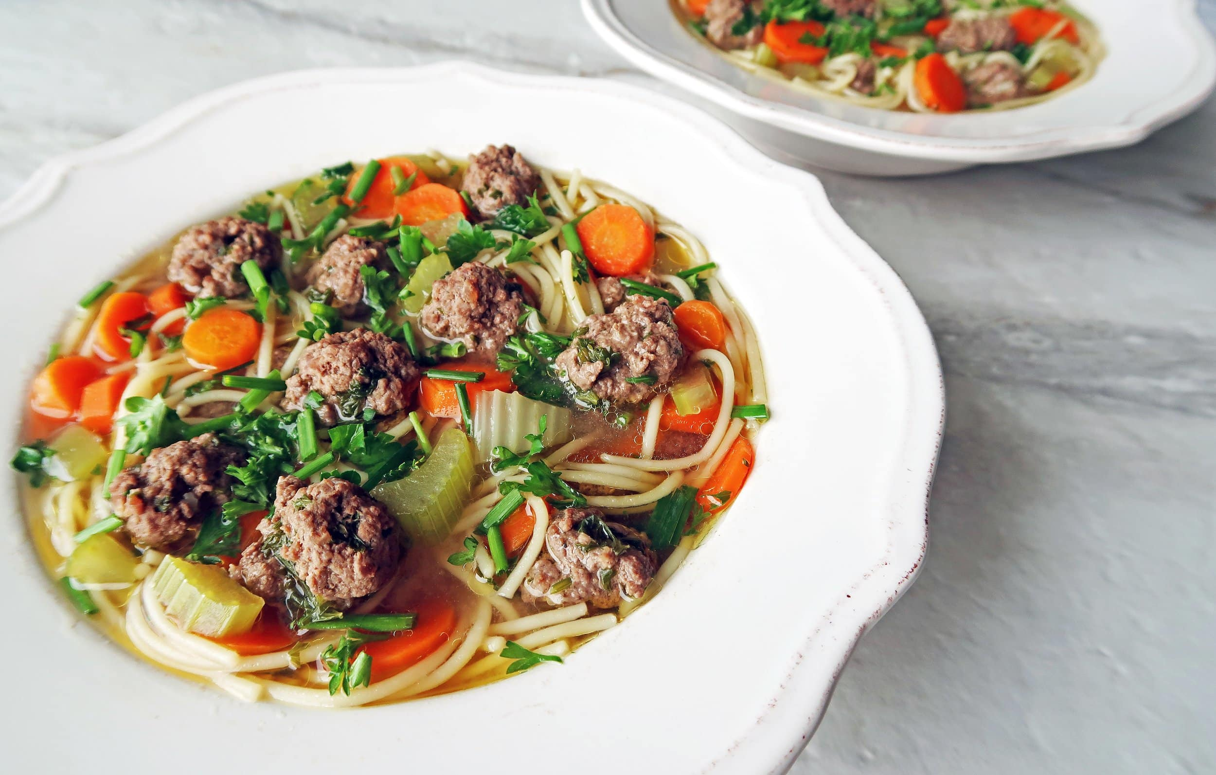 Two bowls of Dutch Vegetable Soup with Meatballs