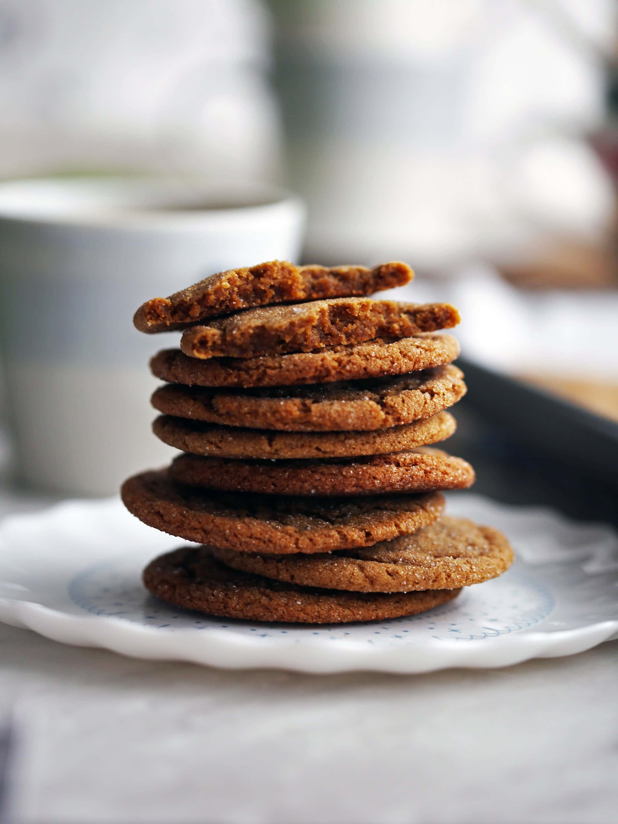 A closeup side view of a stack of chewy thin gingersnap (ginger molasses) cookies.