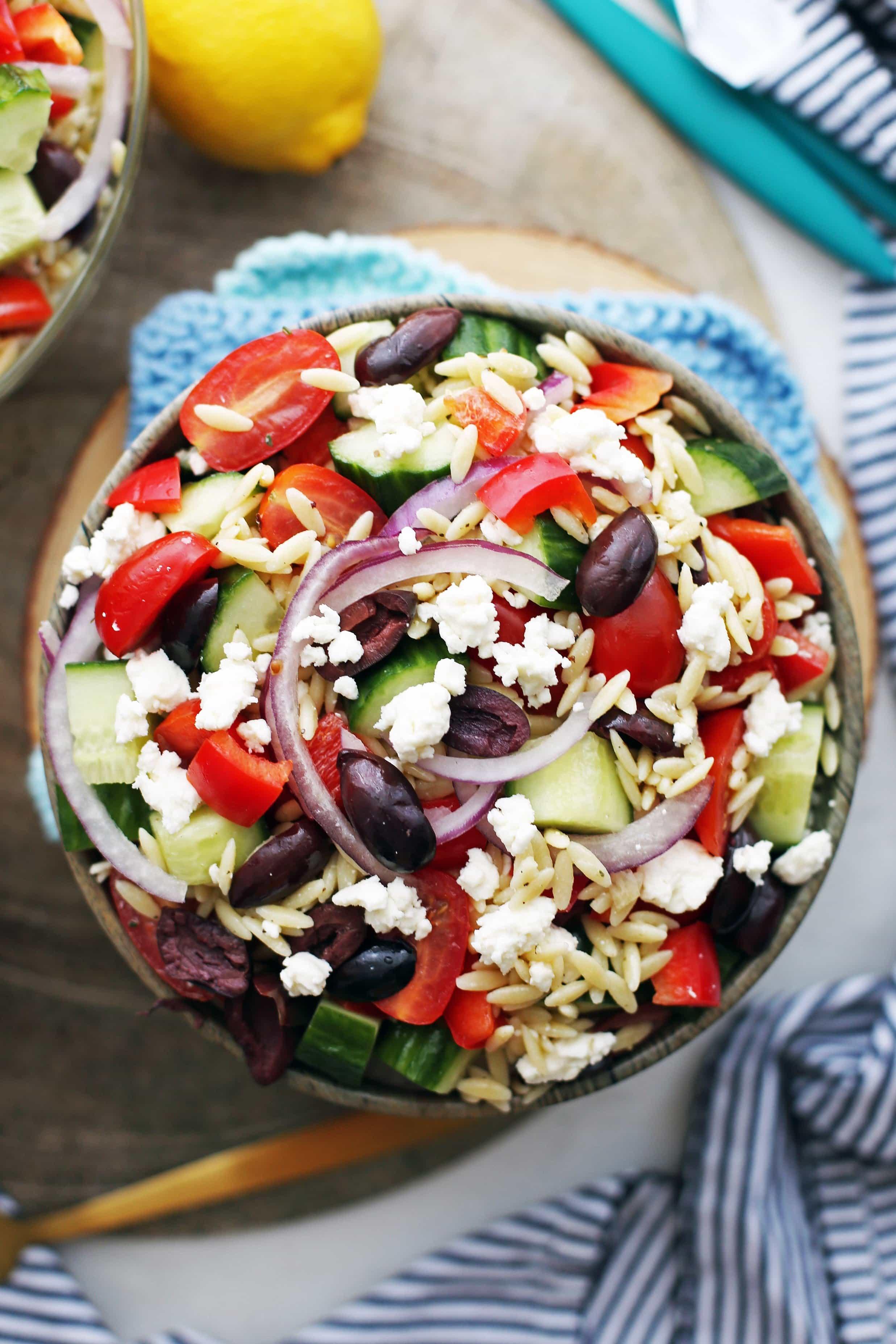 An overhead view of bowl of Greek Orzo Salad with Lemon Vinaigrette.