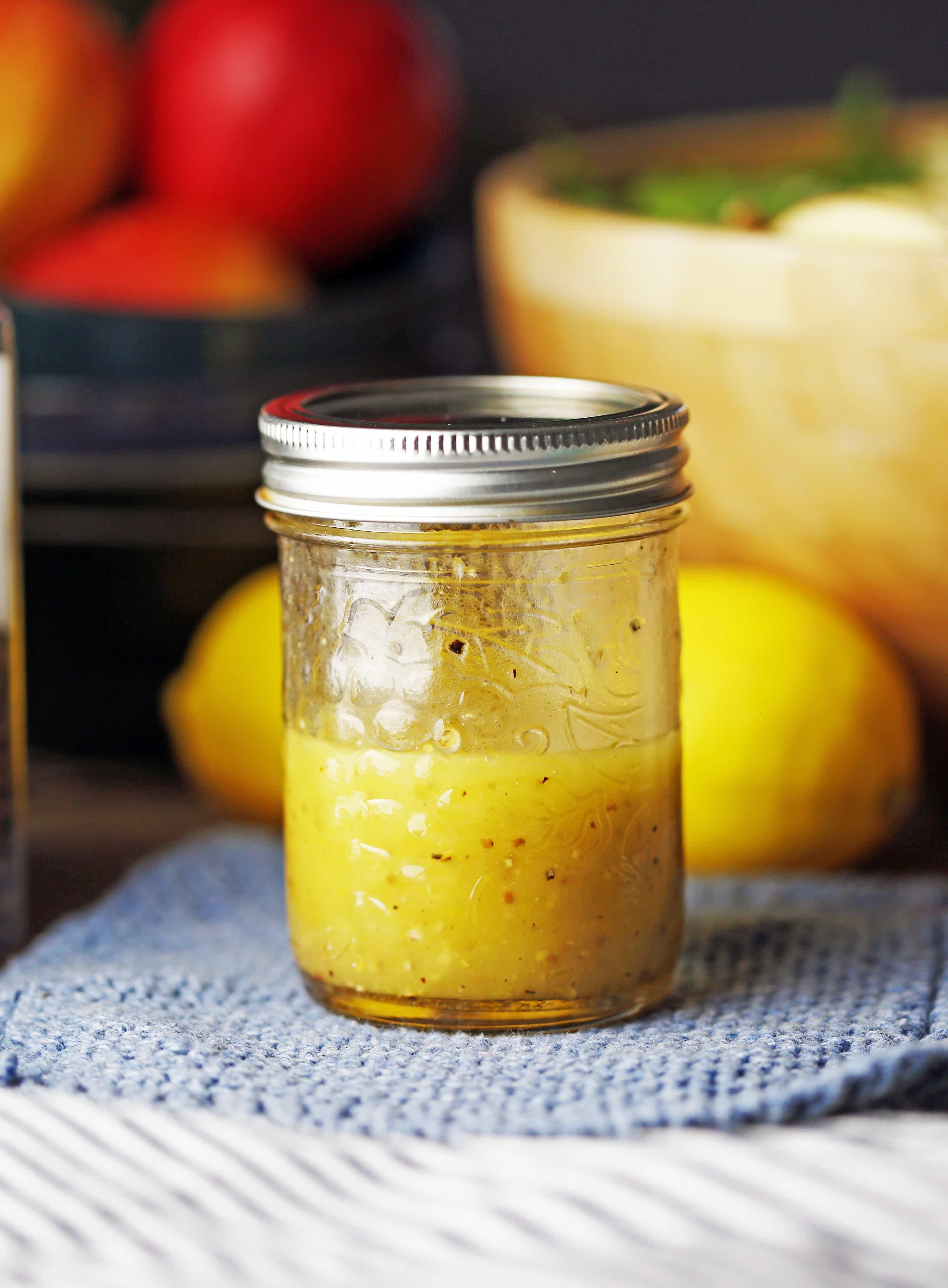 A small mason jar containing honey lemon vinaigrette.
