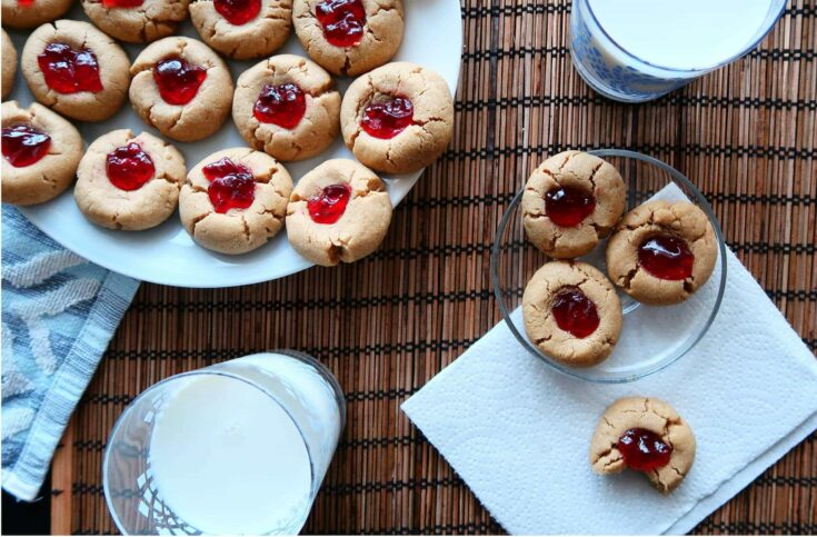Delicious, soft, two-bite peanut butter and jelly thumbprint cookies are extremely easy and fast to make. A wonderful holiday or any day cookie!