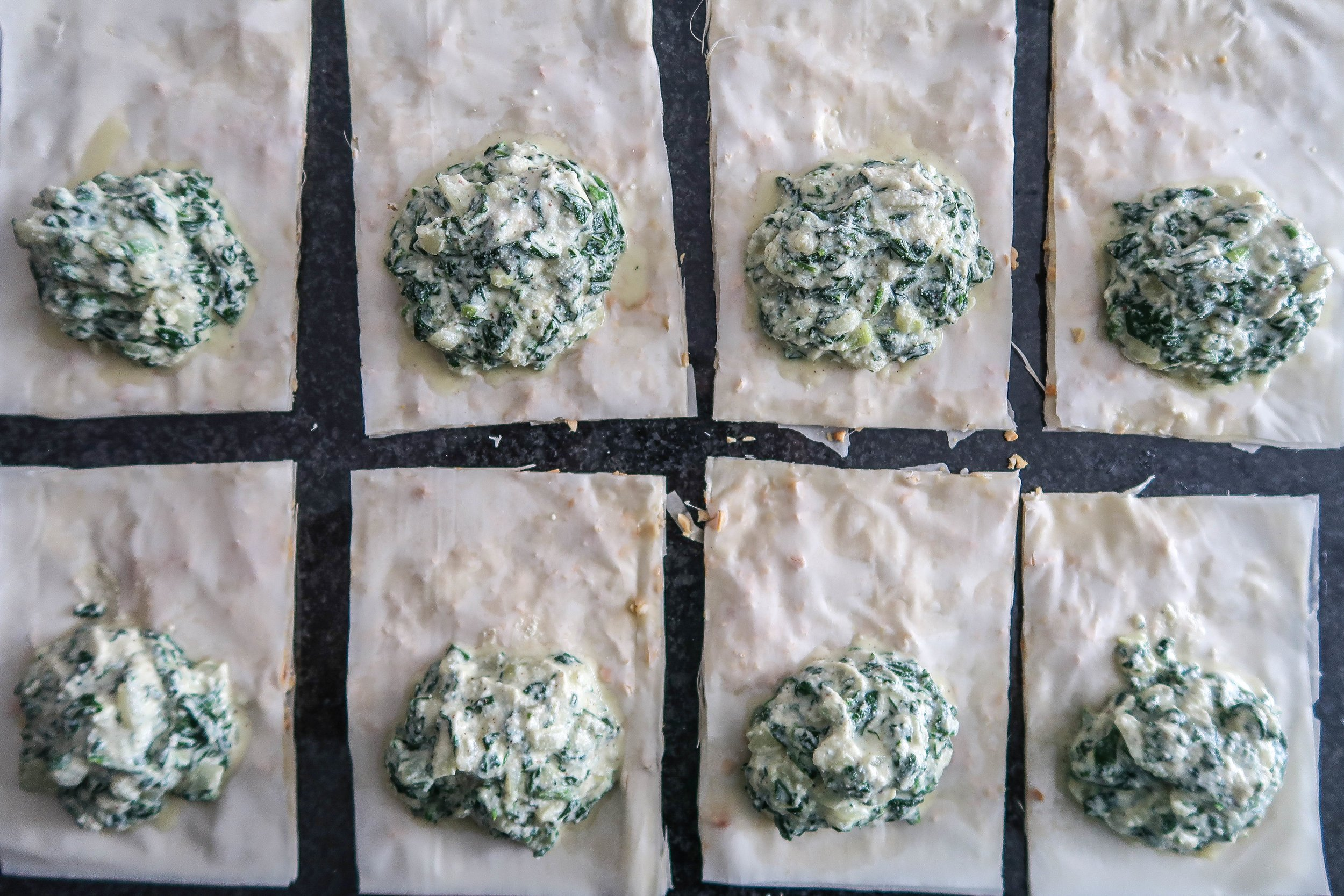 Phyllo dough rectangles with a dollop of spinach and ricotta filling.