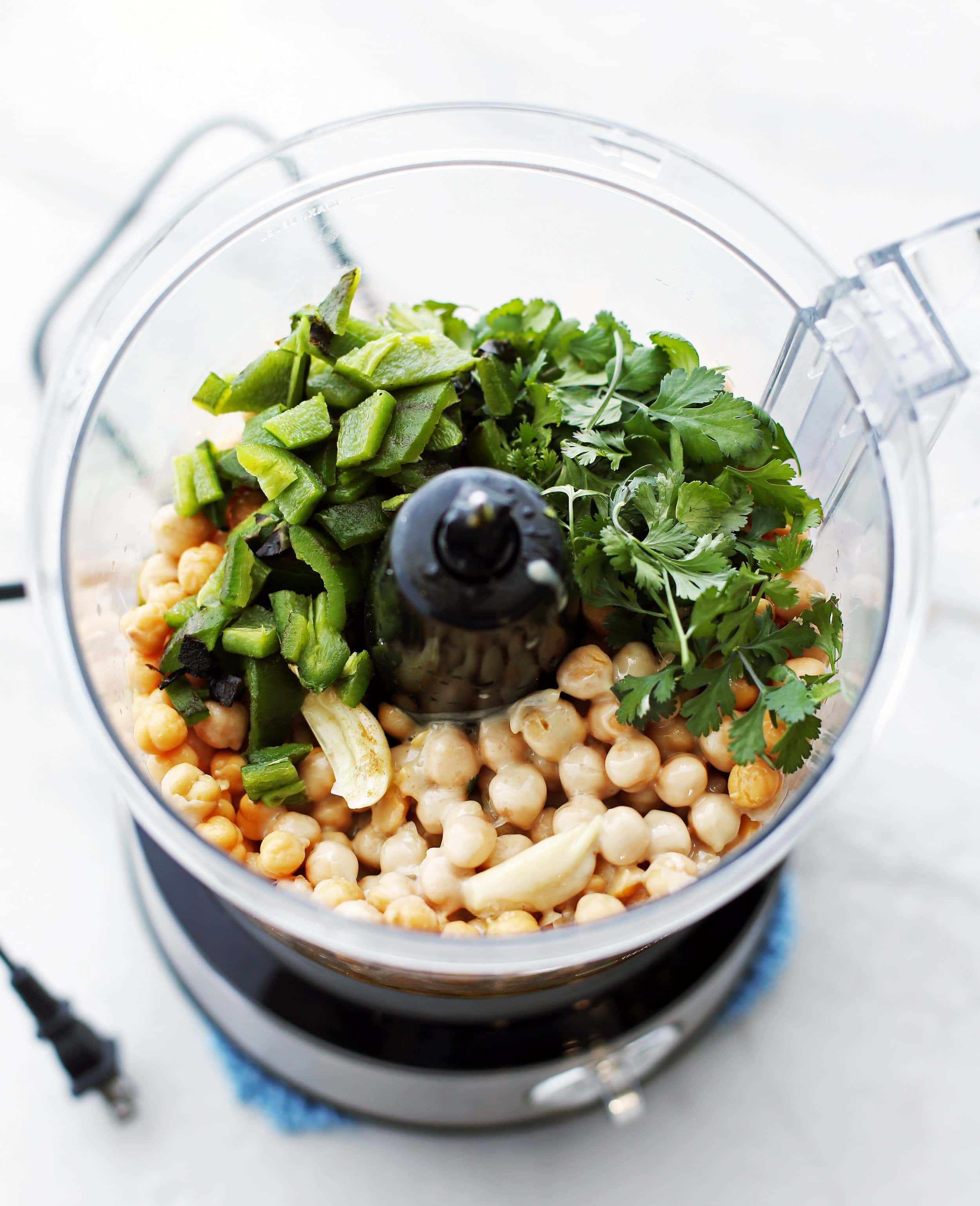 Roasted jalapeno, cilantro, chickpeas, garlic, lemon, olive oil, and spices in a food processor.