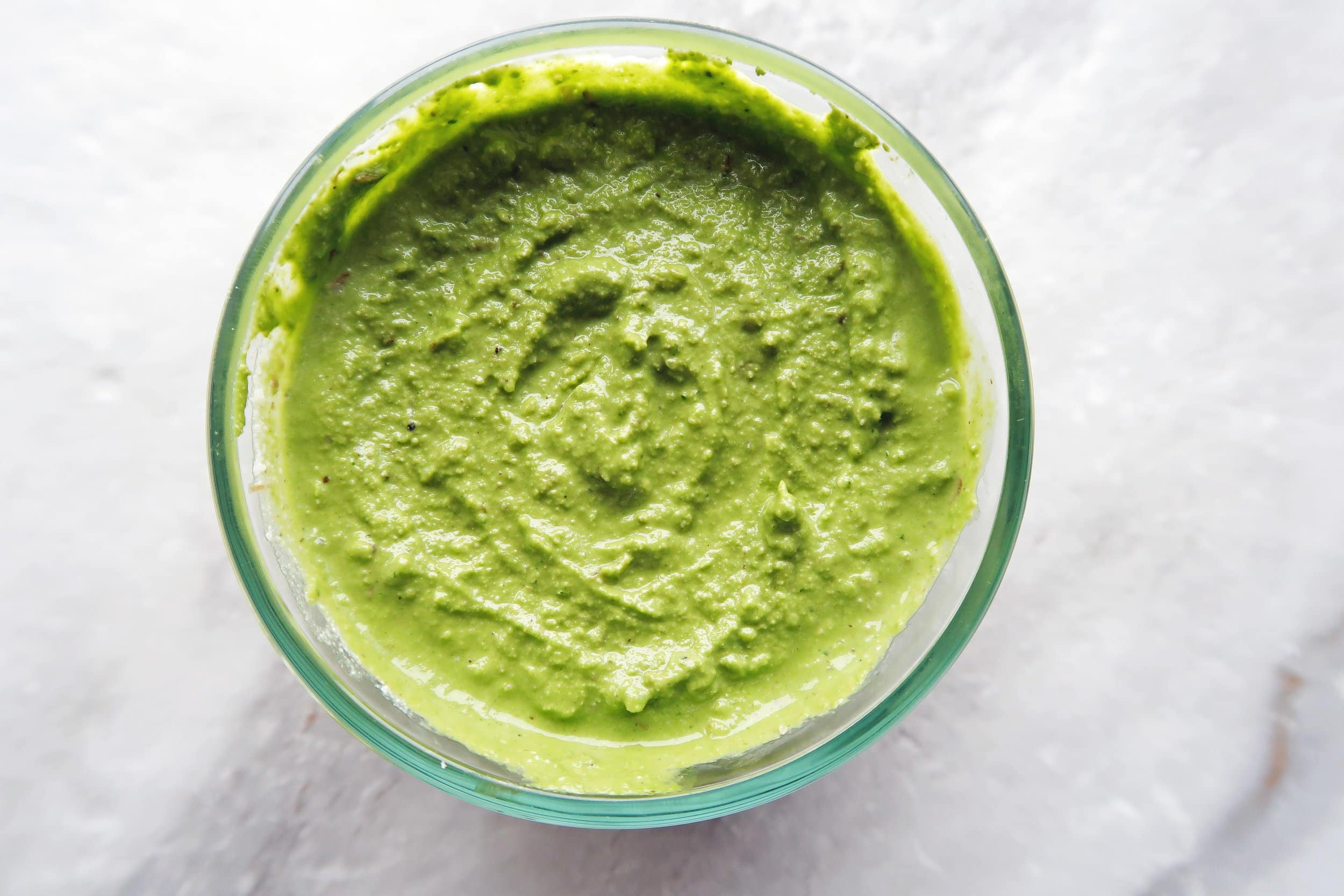 A smooth and creamy pesto in a bowl.