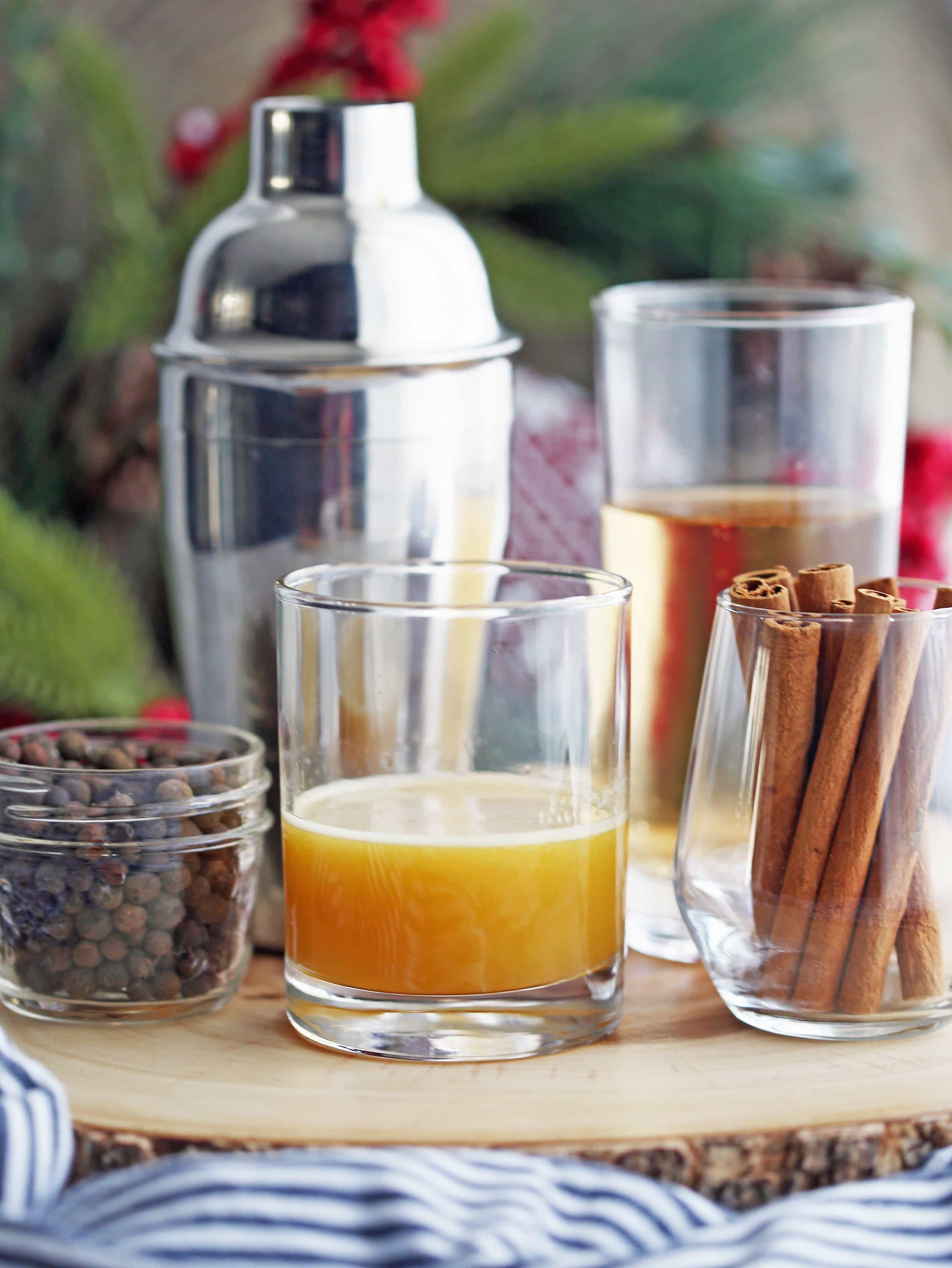 A mixture of brandy, orange juice, and spices in a double-old fashioned glass.