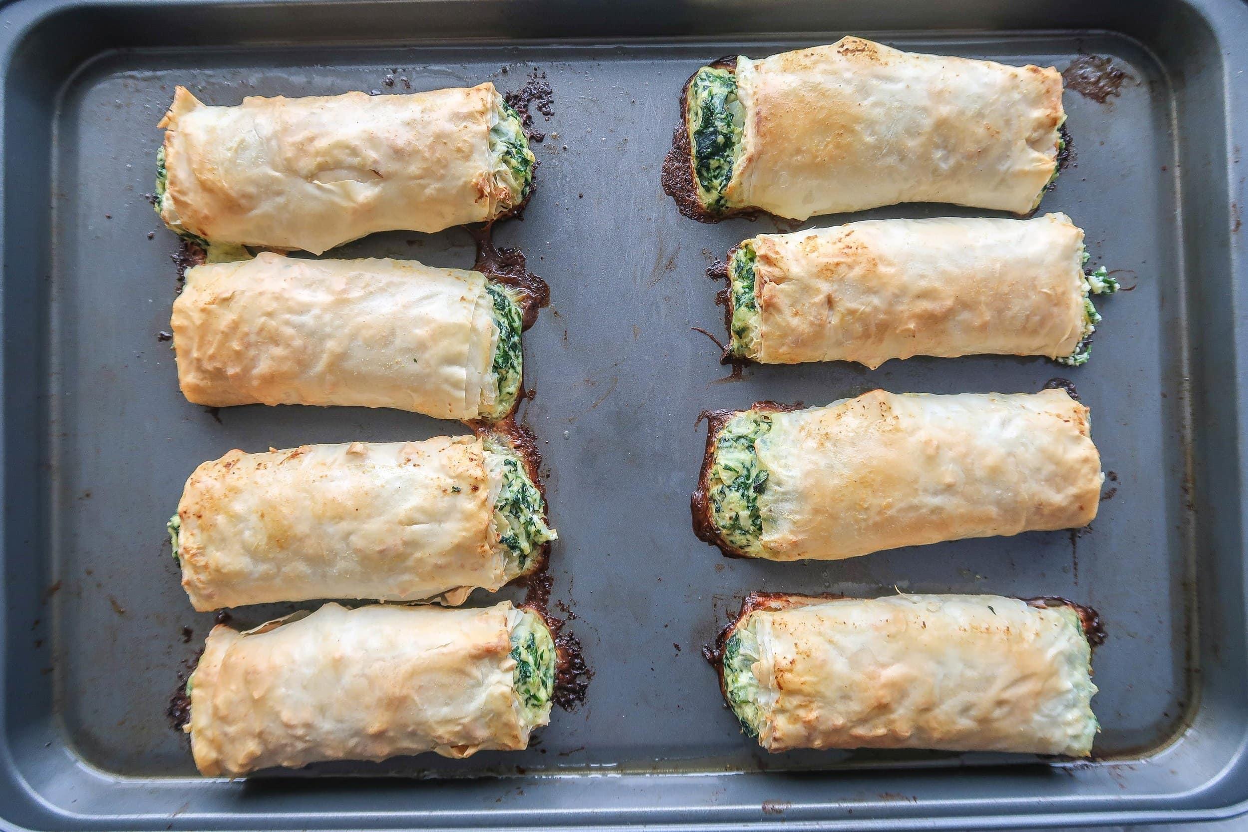 Baked spanakopita rolls.