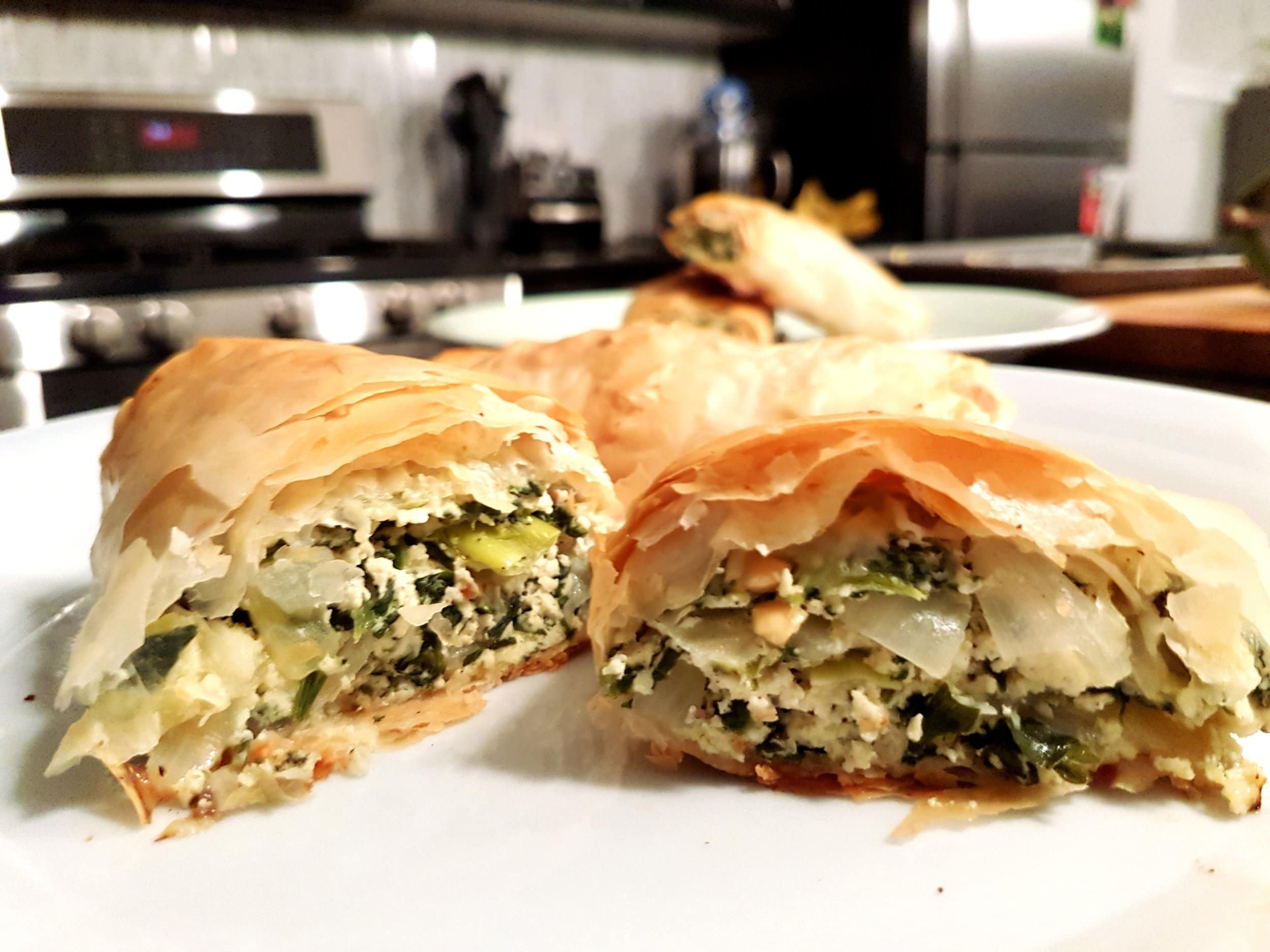 A spanakopita roll cut in half.