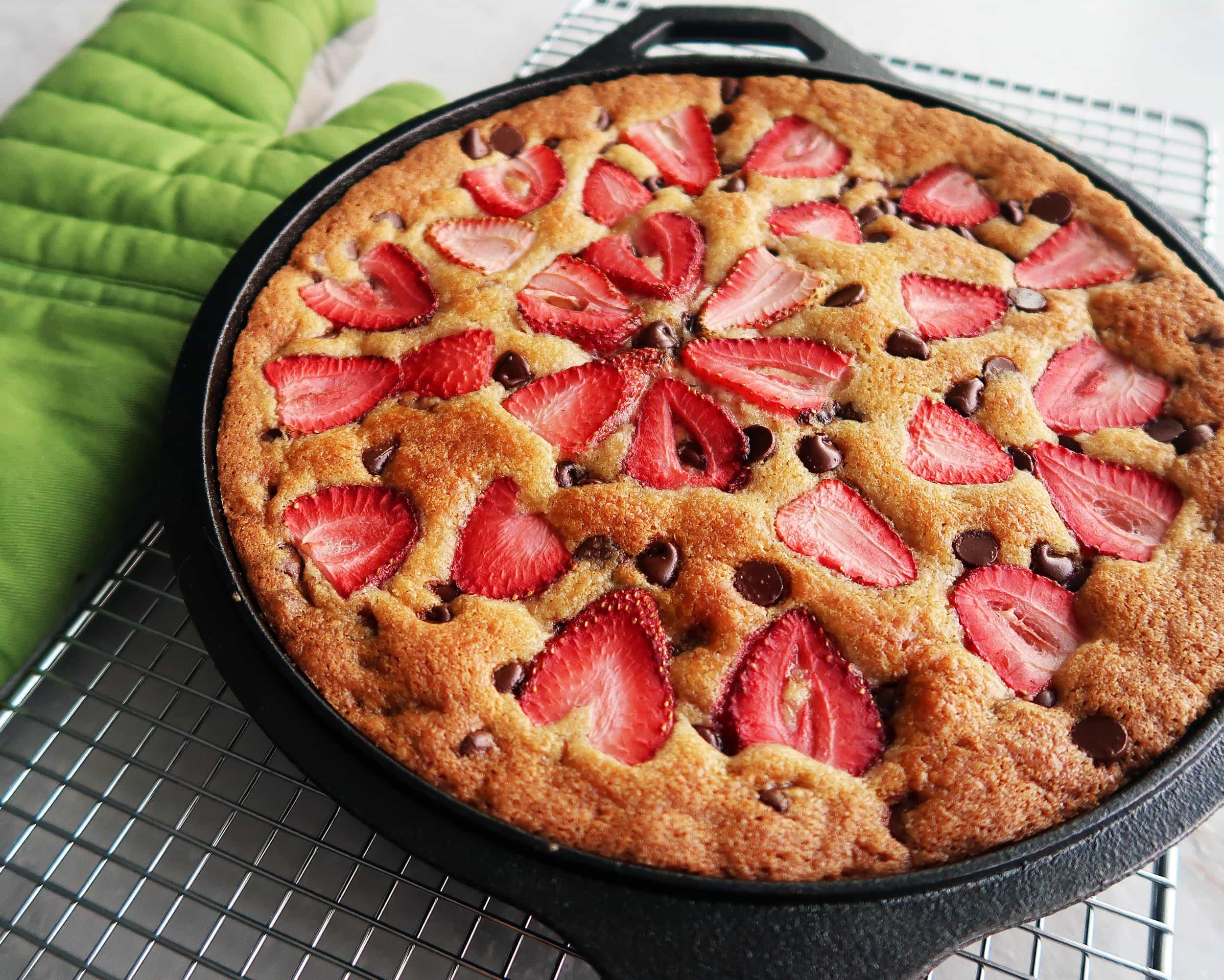 A Strawberry Chocolate Chip Skillet Cookie cooling on a rack.