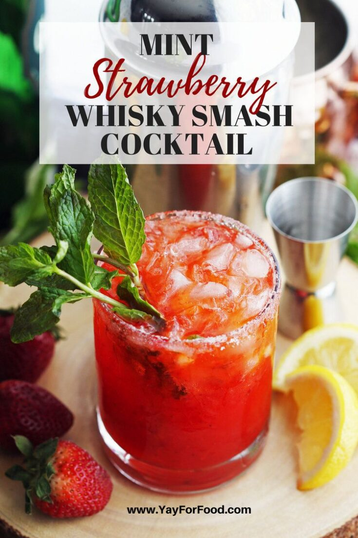 Enjoy this refreshing summer cocktail recipe showcasing sweet strawberries, fresh mint, and whisky! Perfect to drink on a hot day!