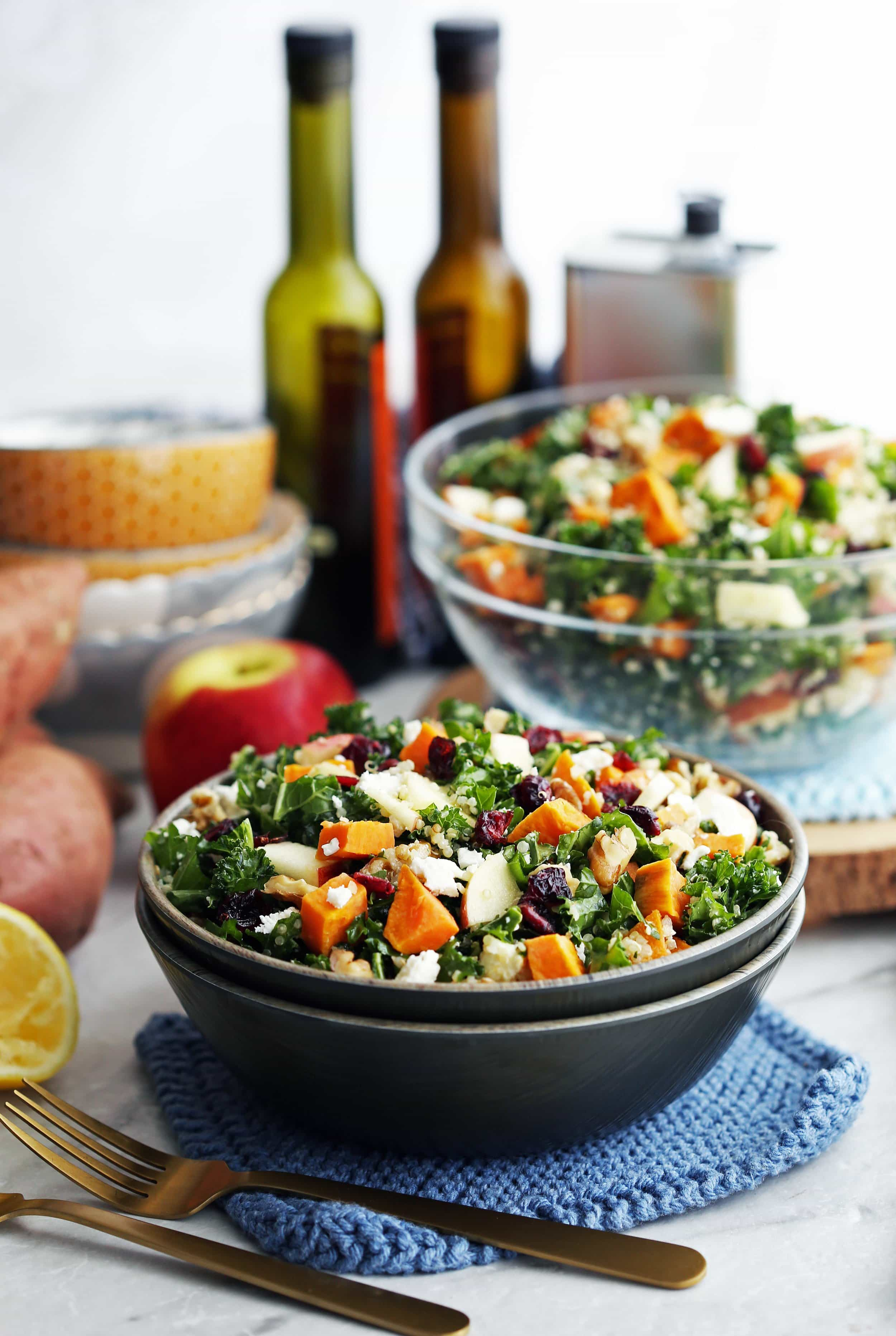 Roasted sweet potato quinoa kale salad in a wooden bowl and a glass bowl.