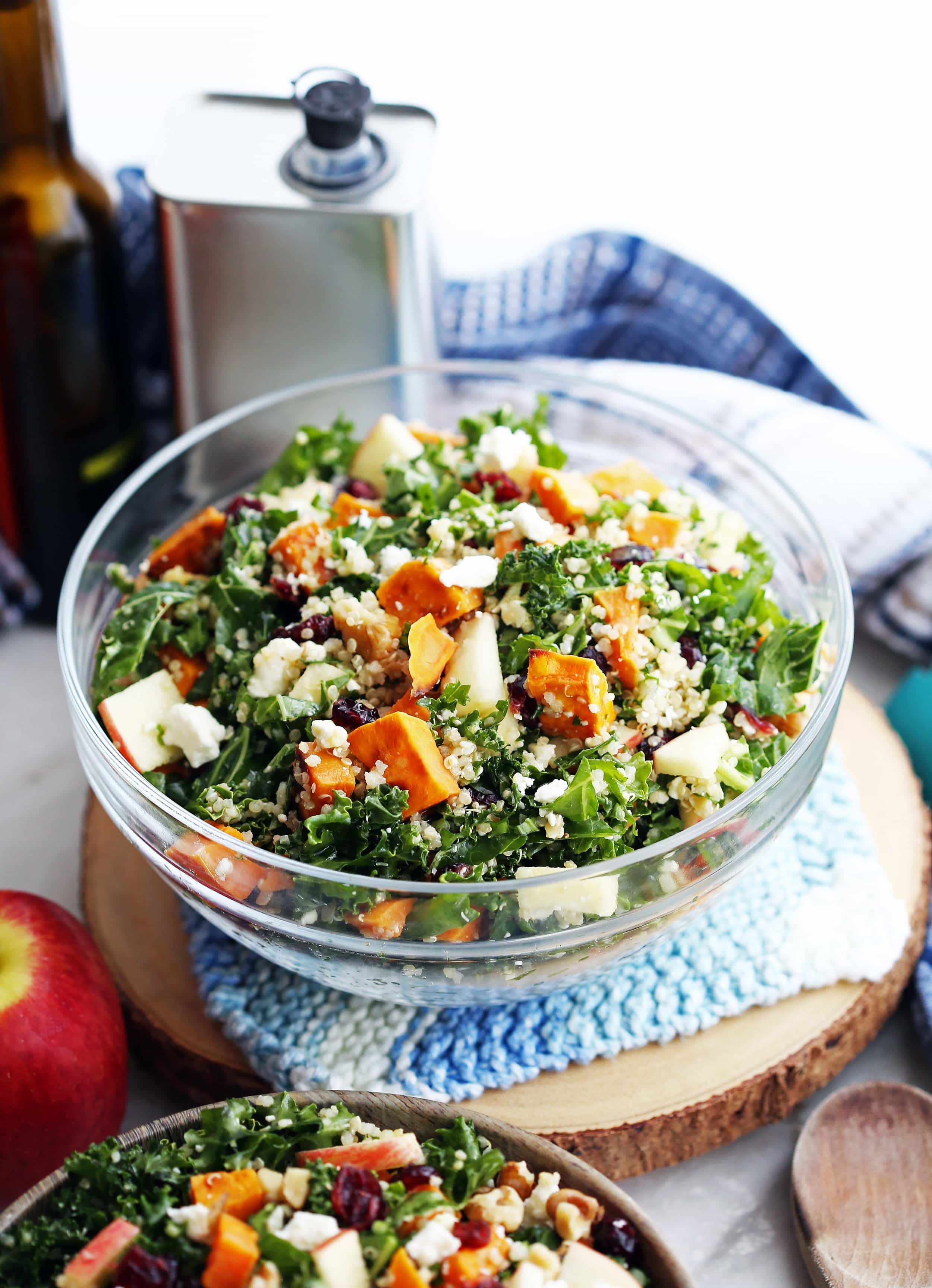Healthy roasted sweet potato quinoa kale salad in a glass bowl.